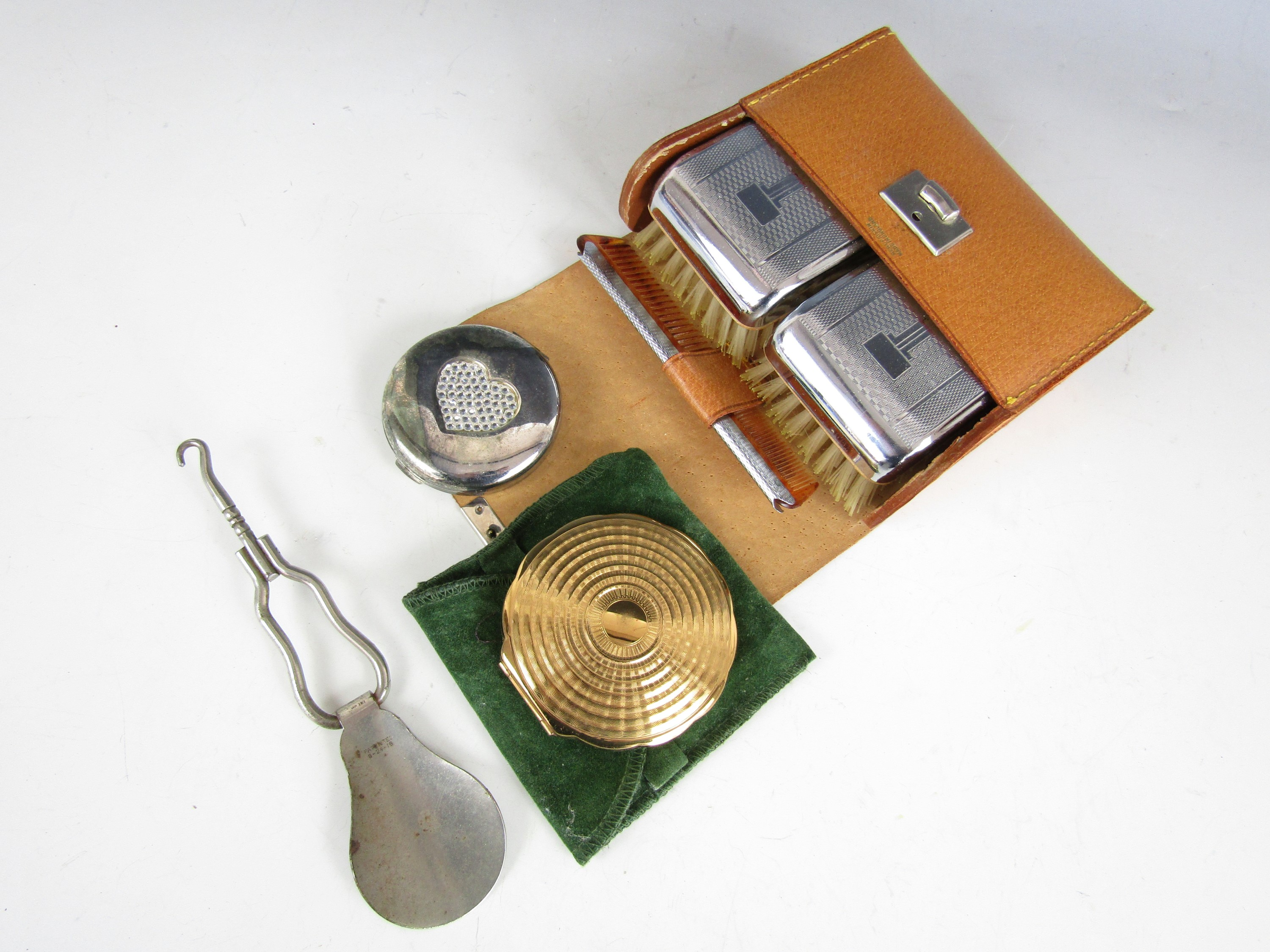 Lot 50 - A gentleman's vintage travel brush set, together with two pressed powder compacts and a folding shoe