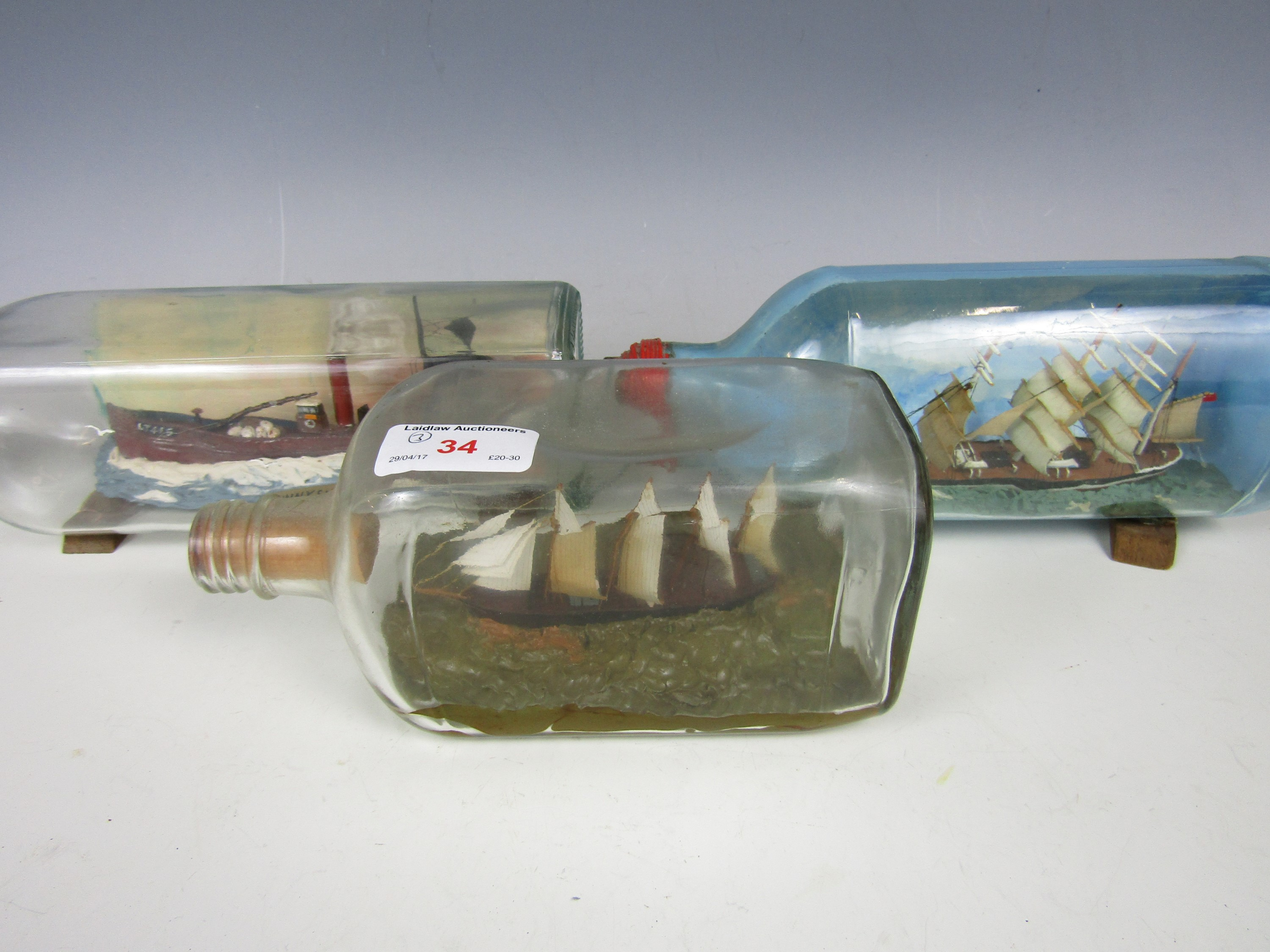Lot 34 - Three vintage ship-in-a-bottle dioramas