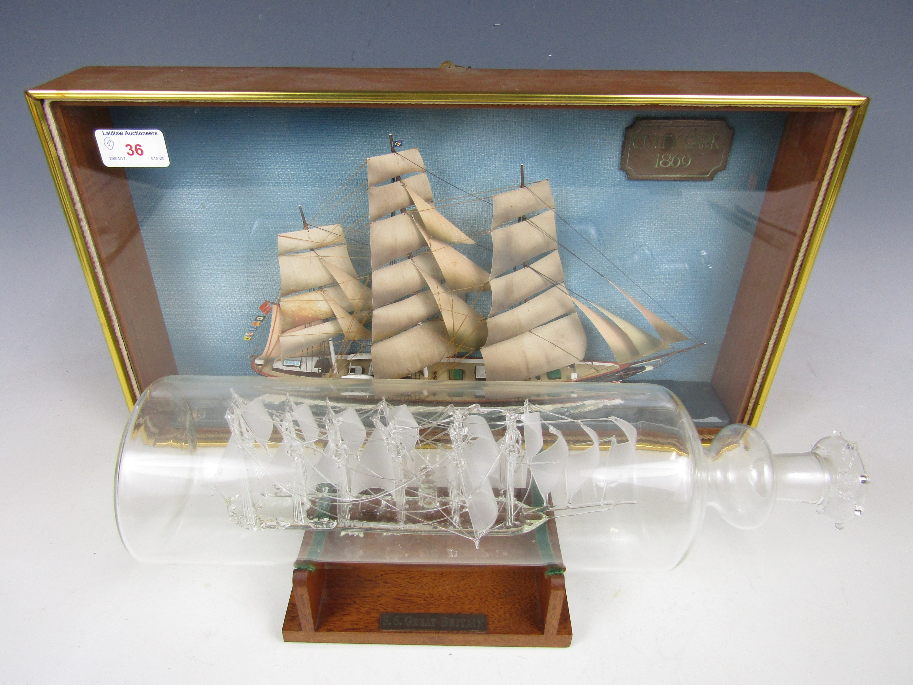 Lot 36 - A glass ship-in-a-bottle depicting the SS Great Britain together with a cased scale model of the