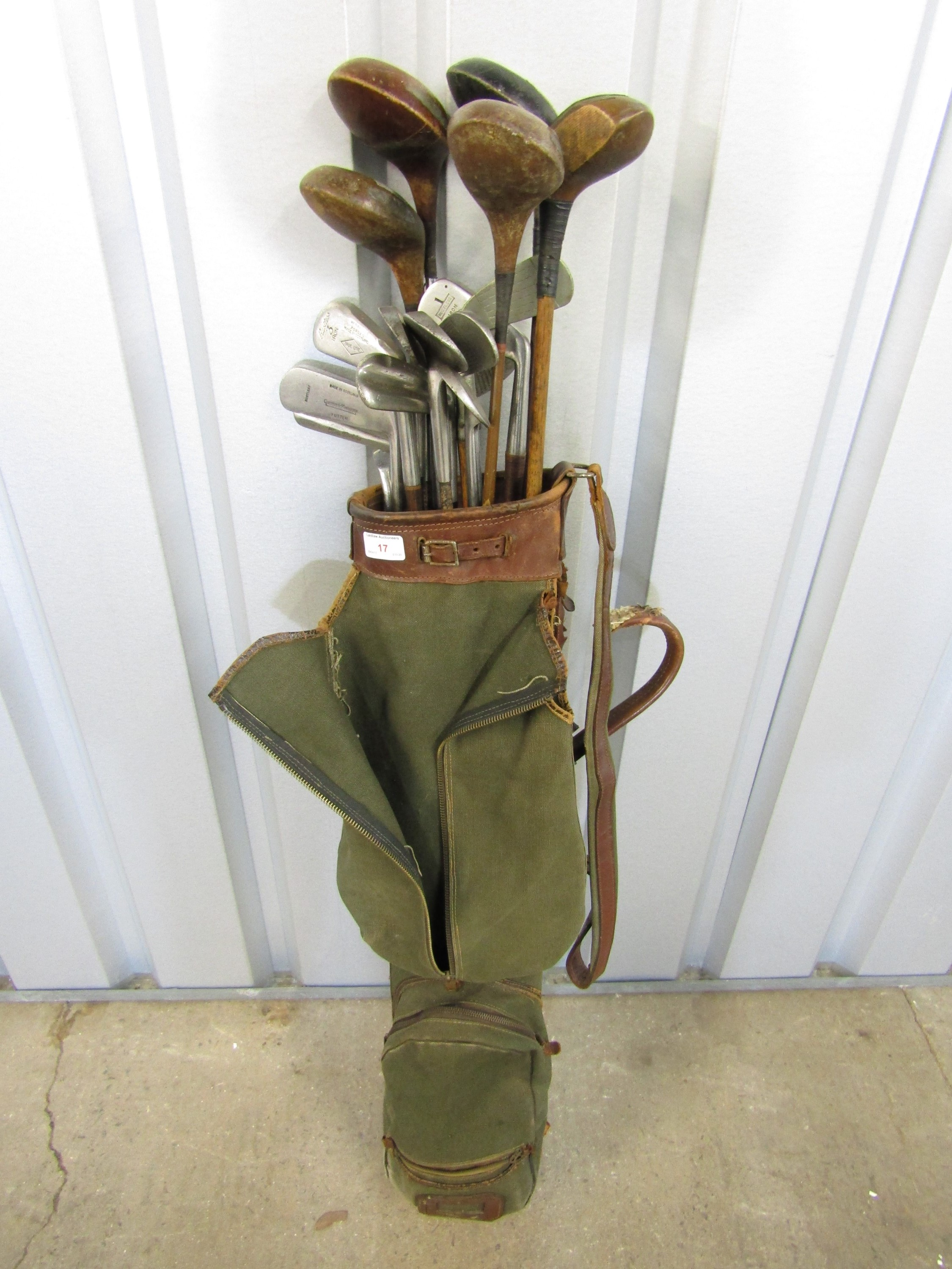 Lot 17 - A vintage golf bag with clubs