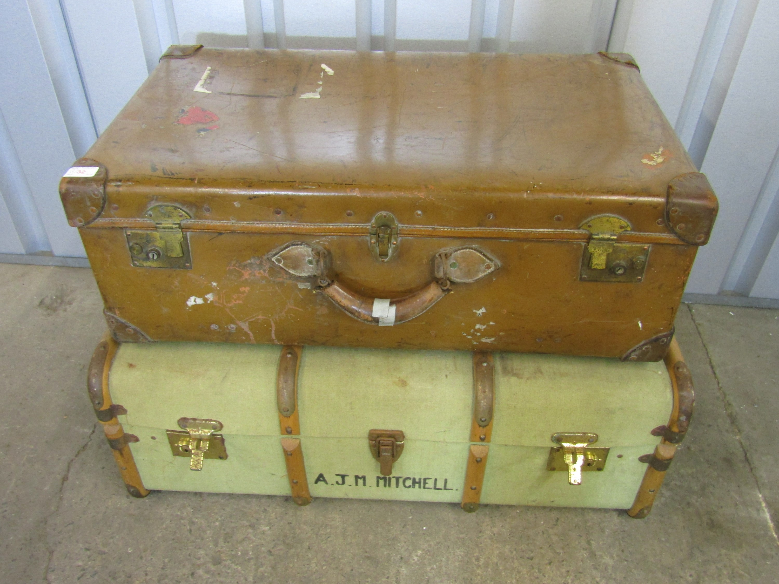 Lot 32 - A large vintage leather luggage case together with a cabin trunk