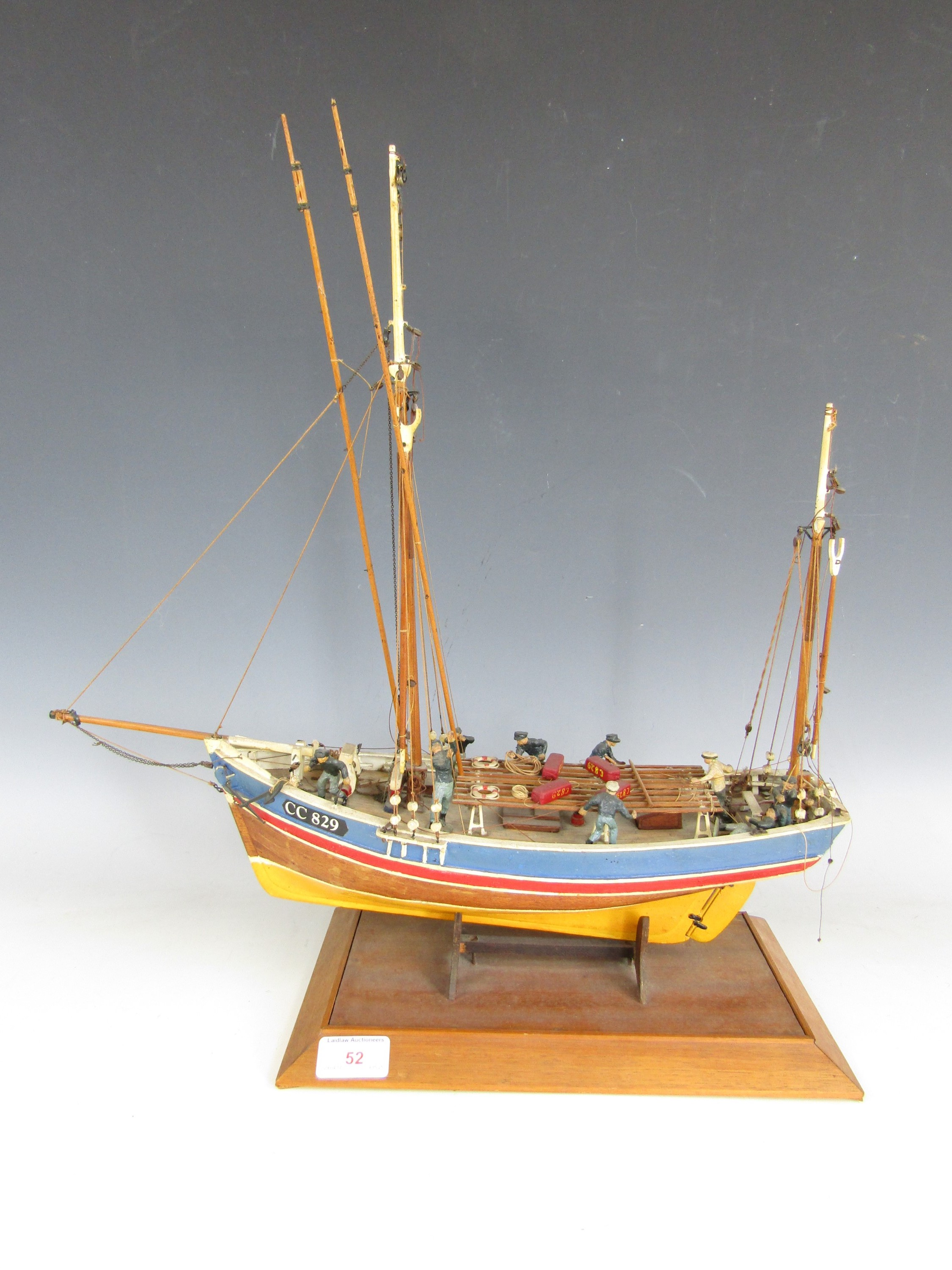 Lot 52 - A hand built model boat of the Marie-Jeanne with figures to the deck