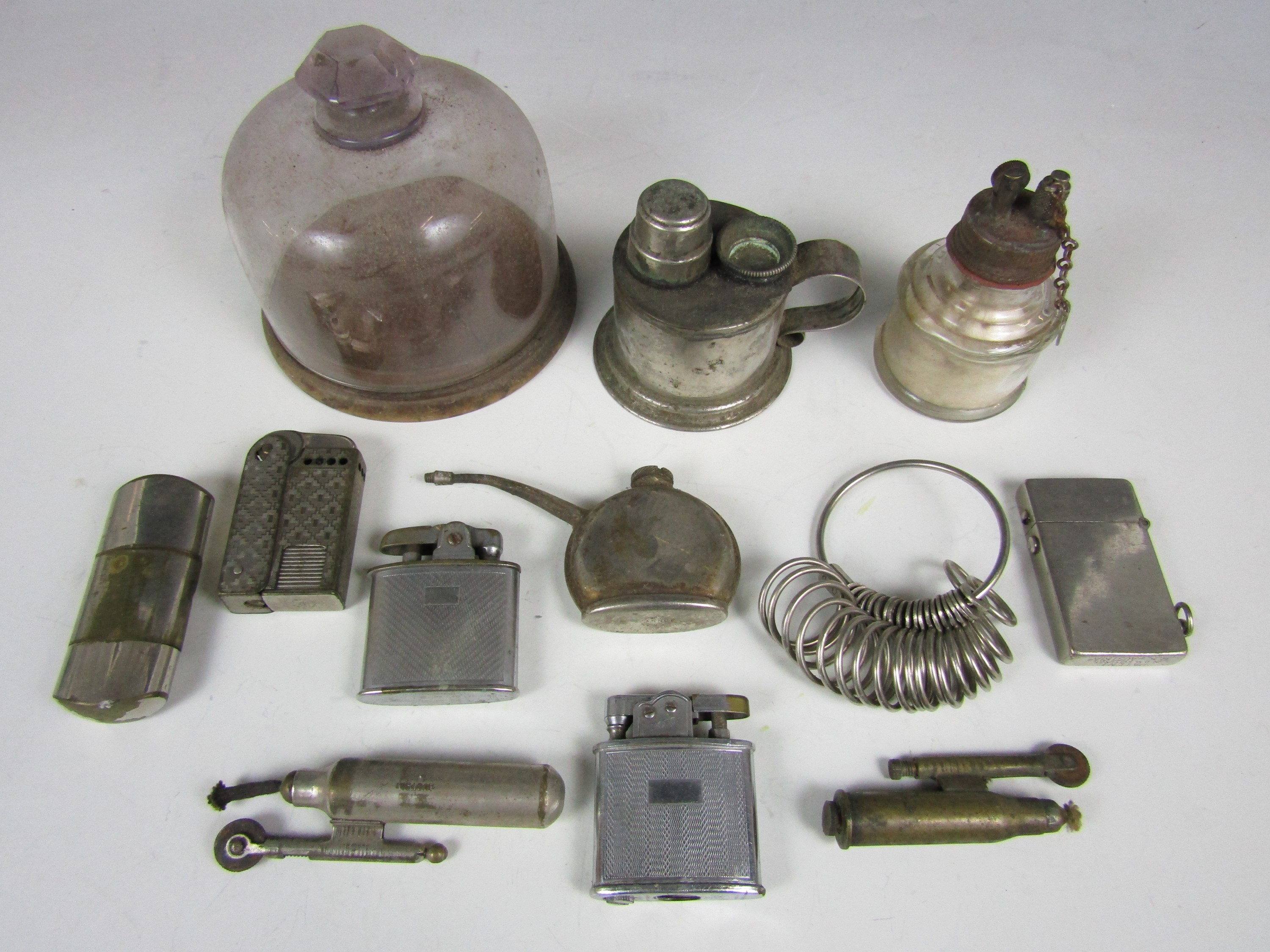 Lot 13 - Sundry collectors' items including a watchmaker's glass dome, a ring gauge and lighters including