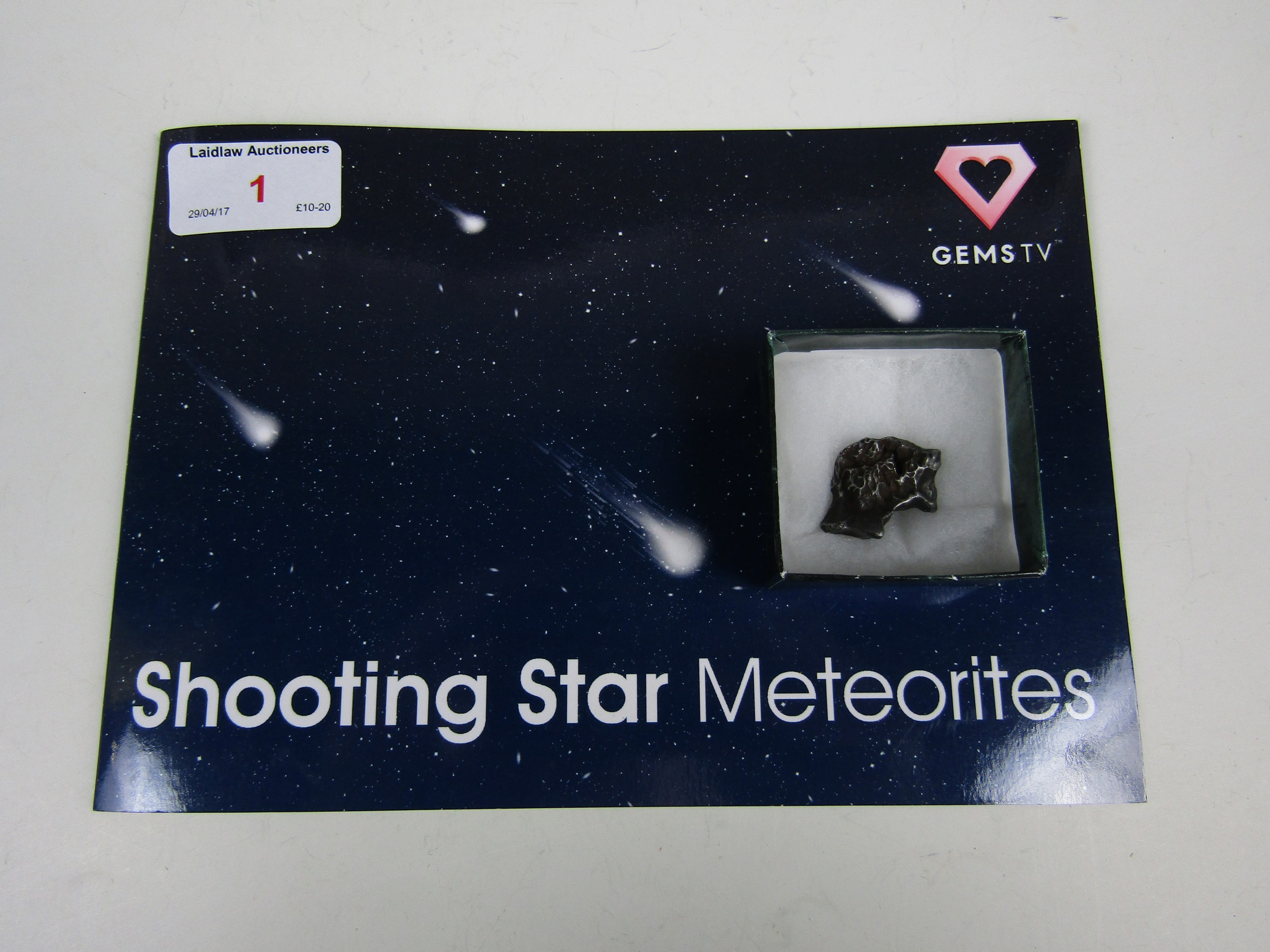 Lot 1 - A shooting star meteorite with presentation booklet