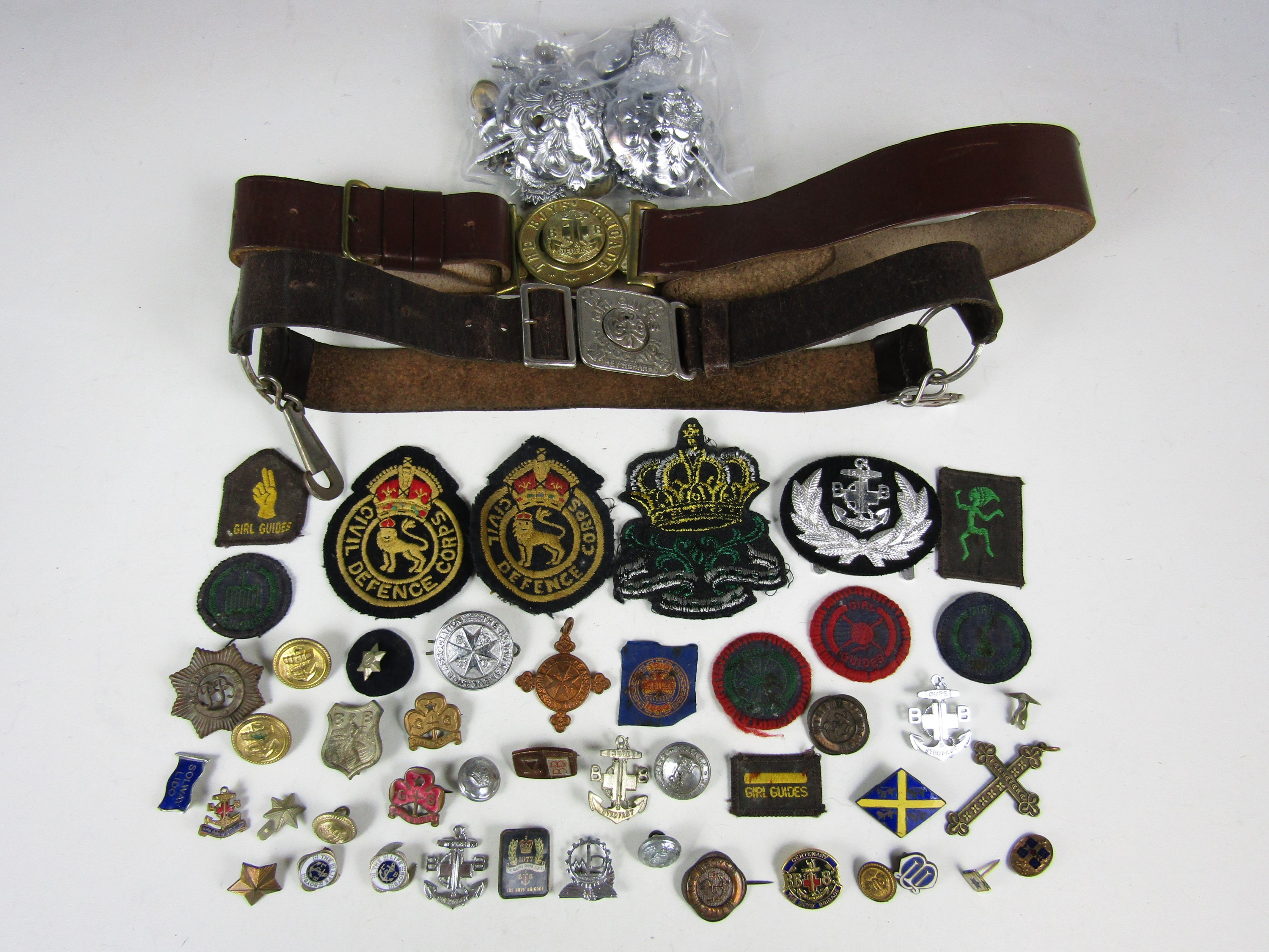 Lot 14 - [Girl Guides / Boys Brigade] Vintage belts, together with sundry cloth and lapel badges etc.