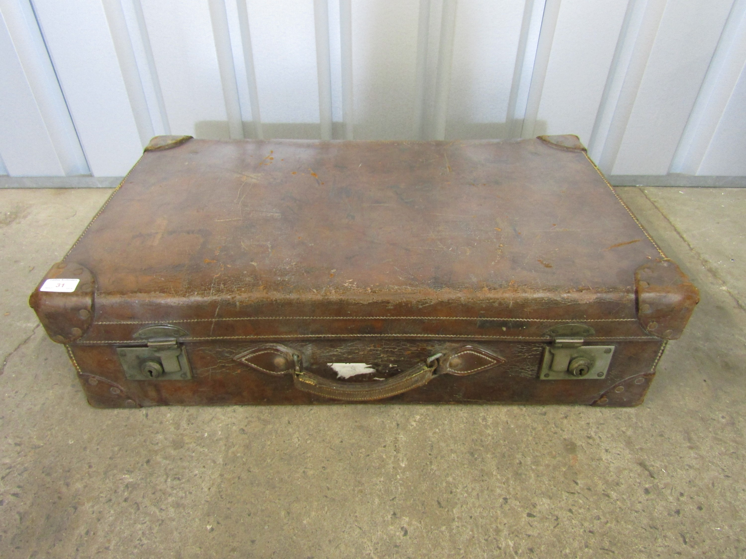 Lot 31 - A large vintage leather luggage case