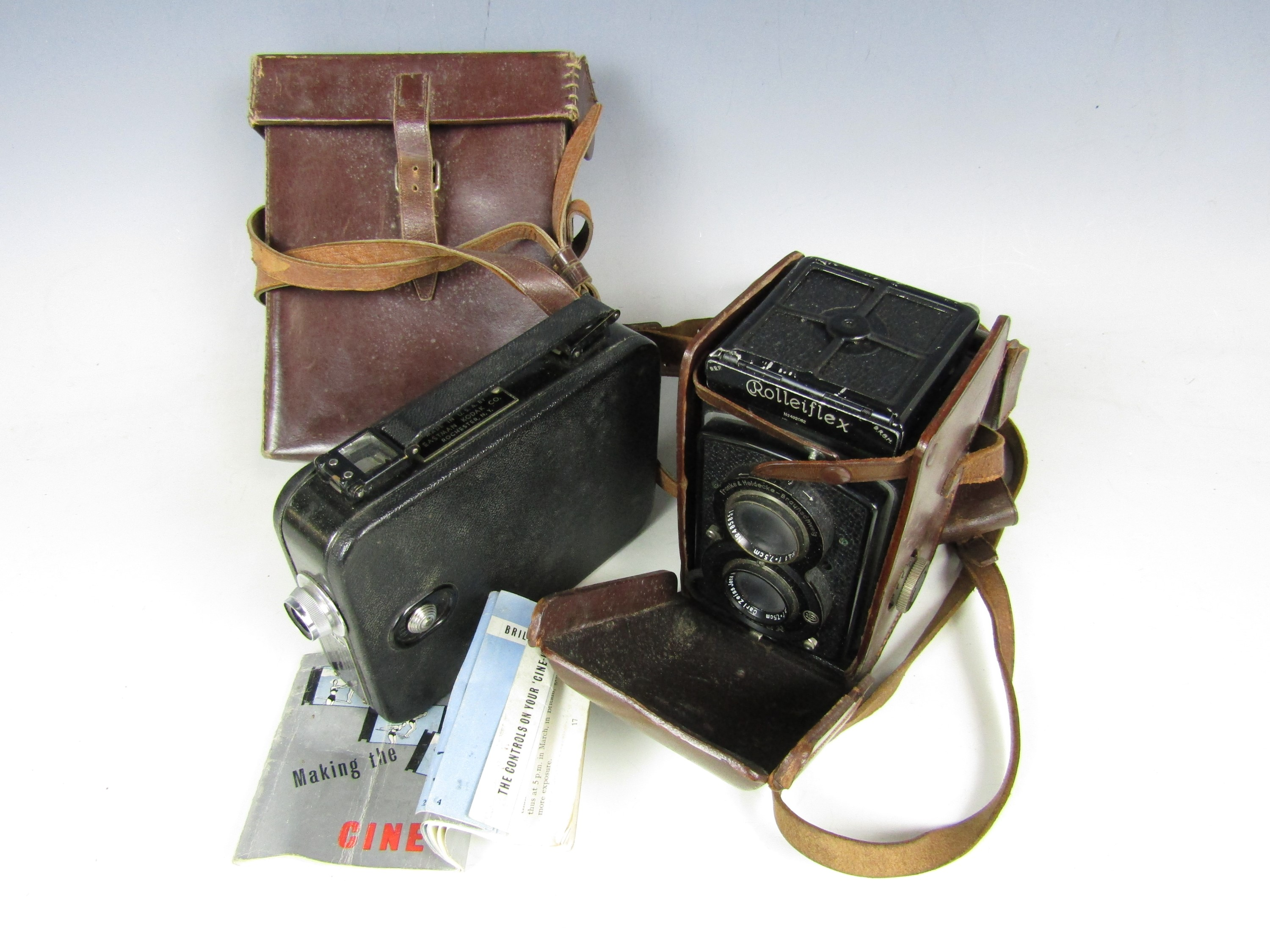 Lot 60 - A vintage Rolleiflex camera together with a Cine-Kodak Eight Model 20 camera with case and