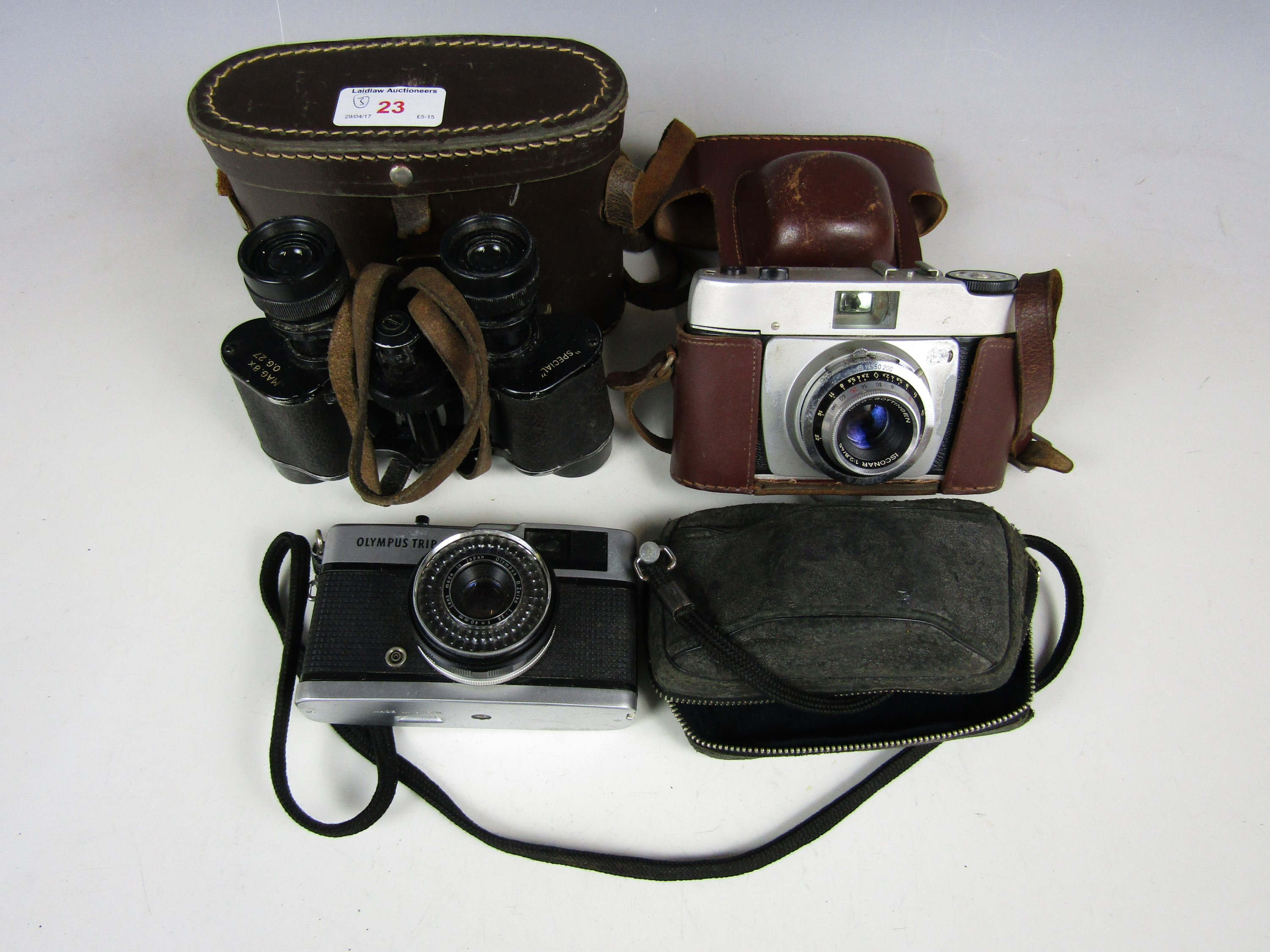 Lot 23 - A cased pair of French binoculars together with two vintage cameras