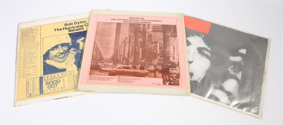 Lot 47 - 3 x Bob Dylan LPs. Four Times Around, Numbered 31/50, splattered vinyl inc 2 b/w prints. The