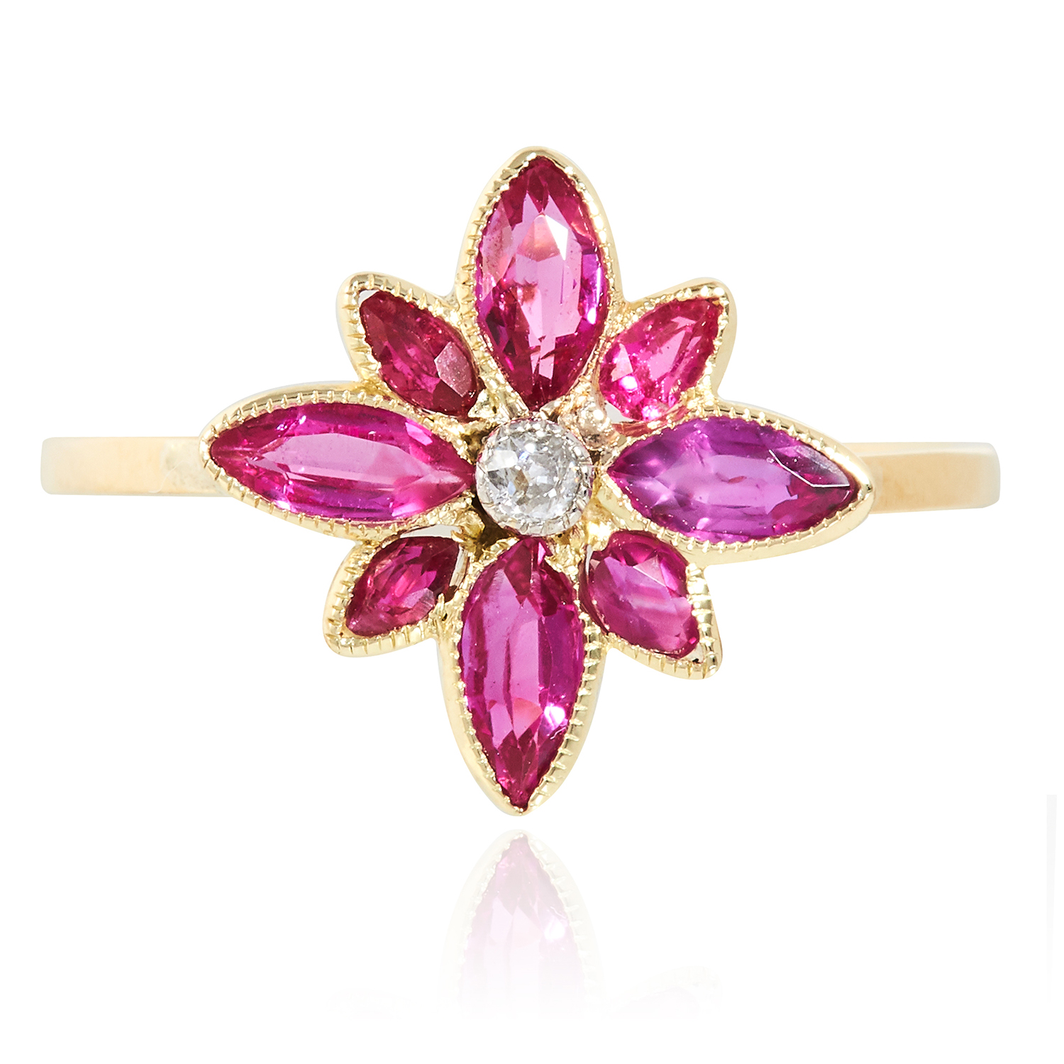 Los 34 - A RUBY AND DIAMOND RING in high carat yellow gold, set with a floral cluster of rubies and diamonds,