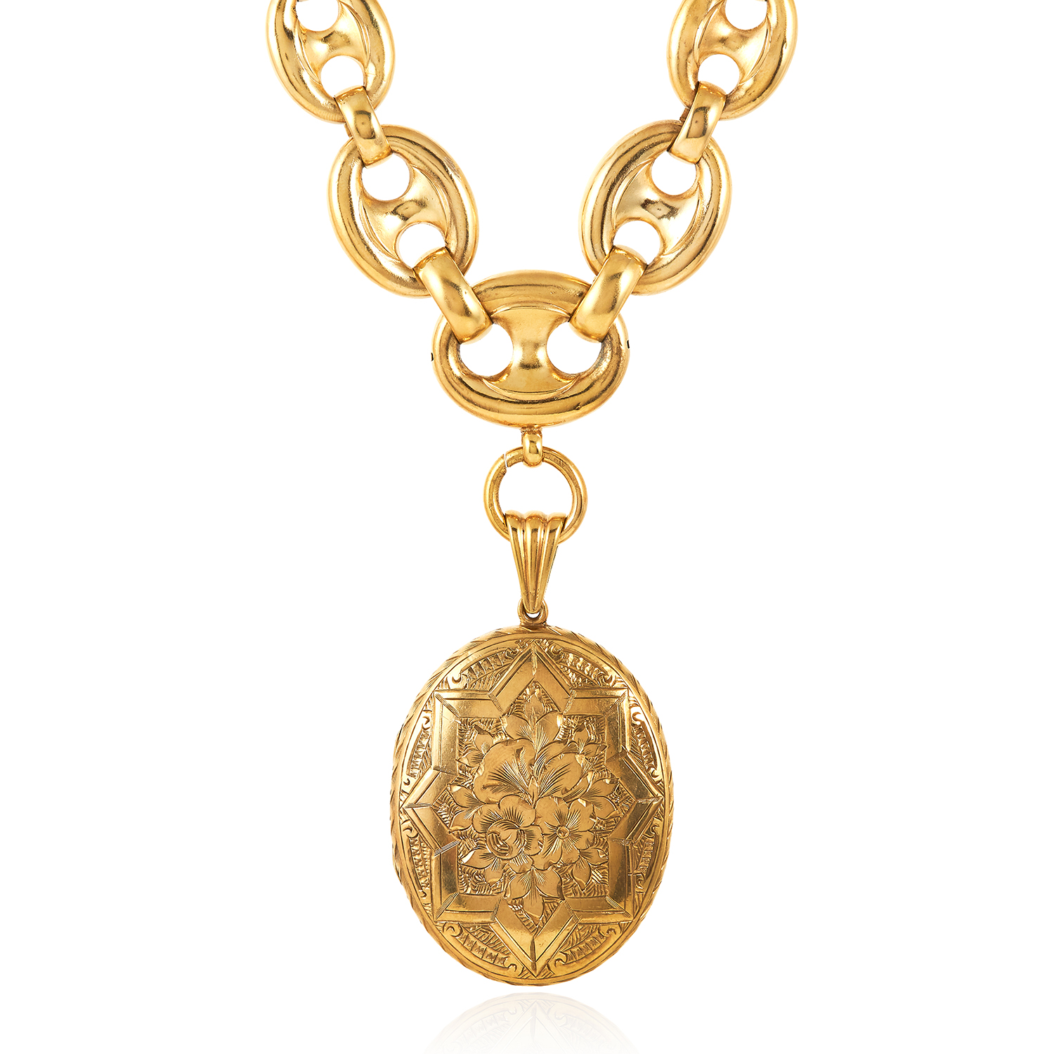 Los 9 - AN ANTIQUE LOCKET AND CHAIN comprising of an oval locket engraved with foliate and star motif, on