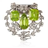 A PAIR OF ANTIQUE PERIDOT AND DIAMOND CLIP BROOCHES in yellow gold and silver, each set with a