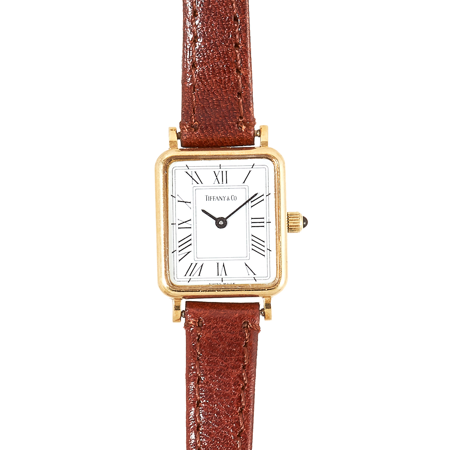 Los 111 - A LADIES WRISTWATCH, TIFFANY AND CO in 14ct yellow gold, with white dial in yellow gold case, on
