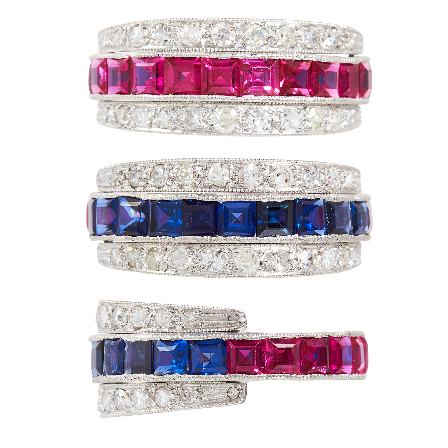 Los 30 - A SAPPHIRE, RUBY AND DIAMOND REVERSIBLE RING in platinum or white gold, the central band half set