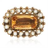 AN ANTIQUE IMPERIAL TOPAZ AND CITRINE BROOCH, 19TH CENTURY in high carat yellow gold, the central
