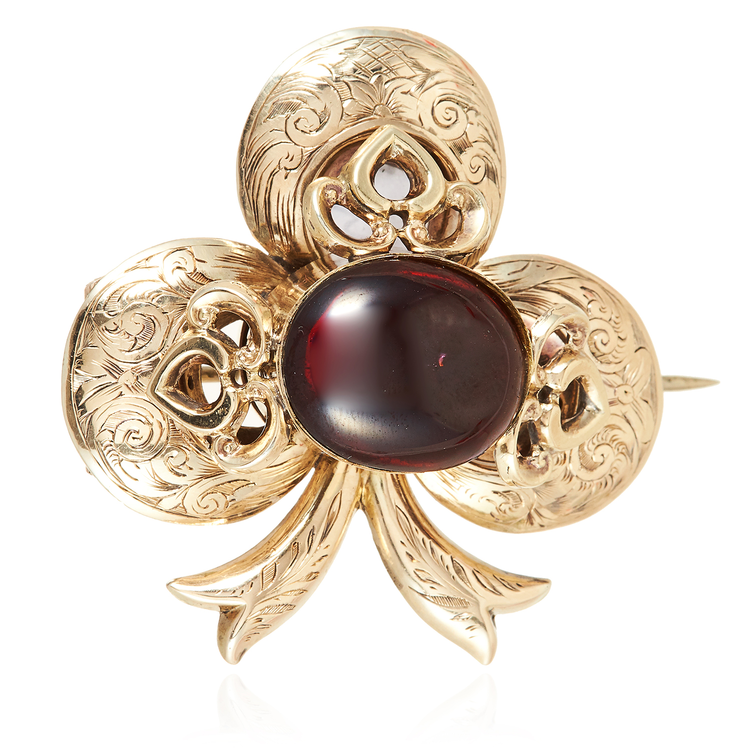 AN ANTIQUE GARNET AND HAIRWORK CLOVER MOURNING BROOCH in high carat yellow gold, the trefoil