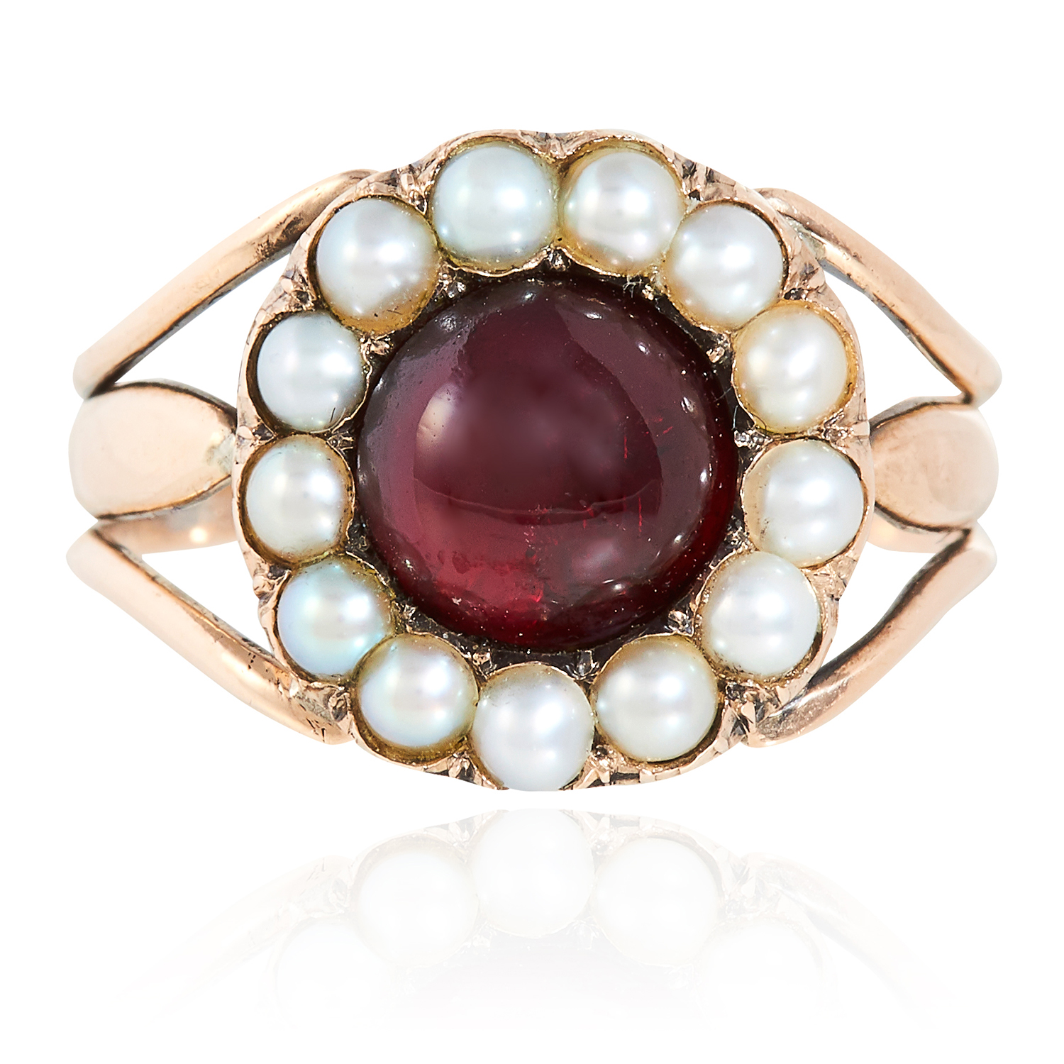AN ANTIQUE GEORGIAN GARNET AND PEARL MOURNING RING, 1806 in high carat yellow gold, the round