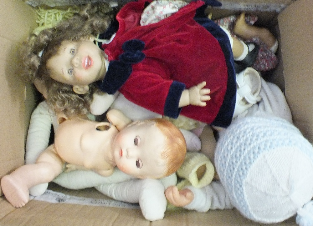 Lot 34 - A box of various dolls