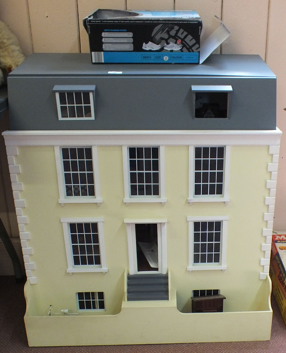 Lot 42 - A large Georgian style dolls house plus a quantity of furniture