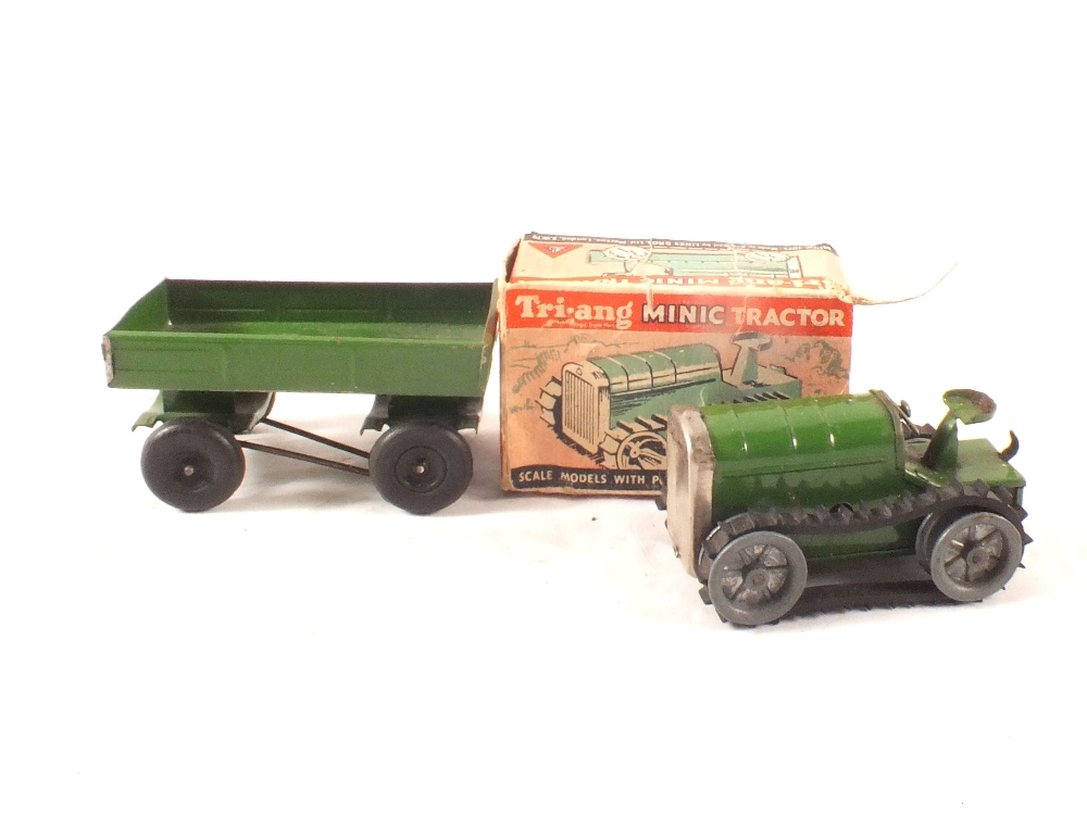 Lot 59 - A boxed Minic tractor (one flap detached) and green trailer