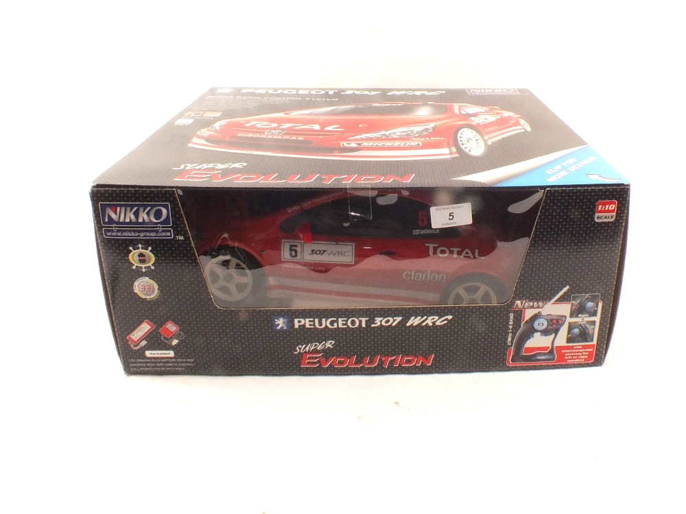 Lot 5 - A boxed Nikko radio controlled Peugeot 307 WRC