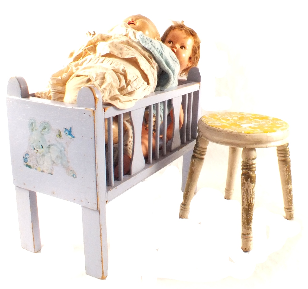 Lot 49 - A childs swan rocker, stool, wooden train,