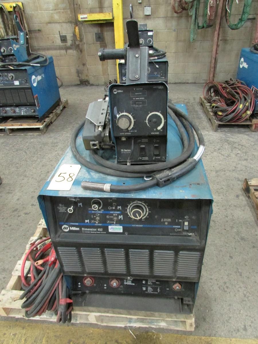 Lot 58 - Miller Dimension 452 welder, s/n LC709927 c/w 70 Series 24V wire feed welding gun w/ generous length