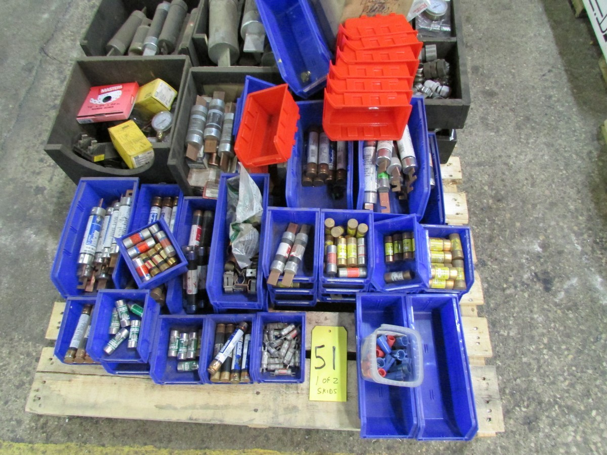 Two skids of various sized fuses, elec. components, fittings, connectors, etc.