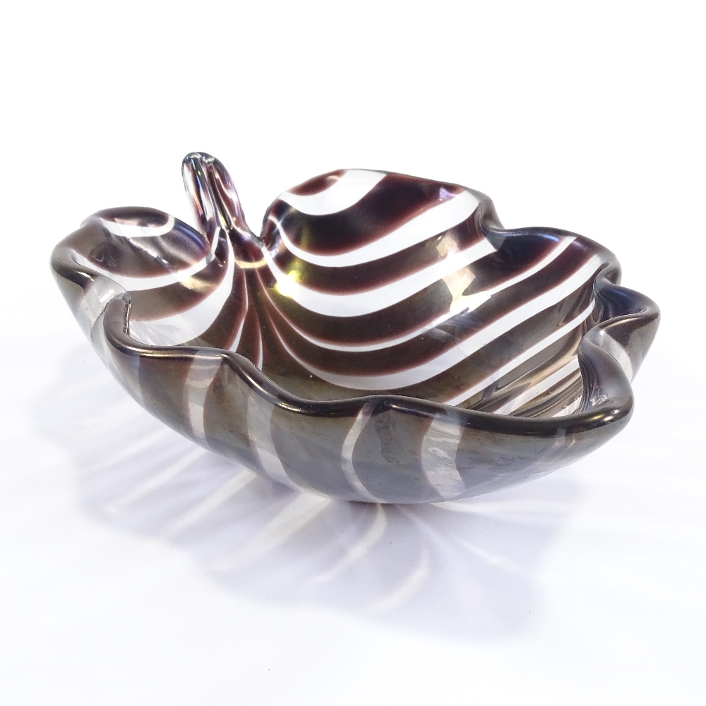 TYRA LUNDGREN FOR VENINI - a 1930s thick Murano glass leaf bowl, amethyst coloured stripes with wave - Image 2 of 5