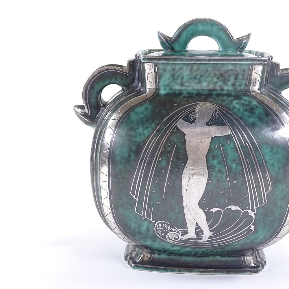 WILHELM KAGE FOR GUSTAVSBERG - an Art Deco Swedish green glaze ceramic Argenta urn and cover,