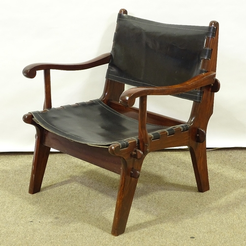 ANGEL PAZMINO - a Mid-Century Ecuadorian rosewood stained teak lounge chair, leather sling seat