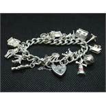 Vintage silver charm bracelet with 15x charms HM London 1955 69grams