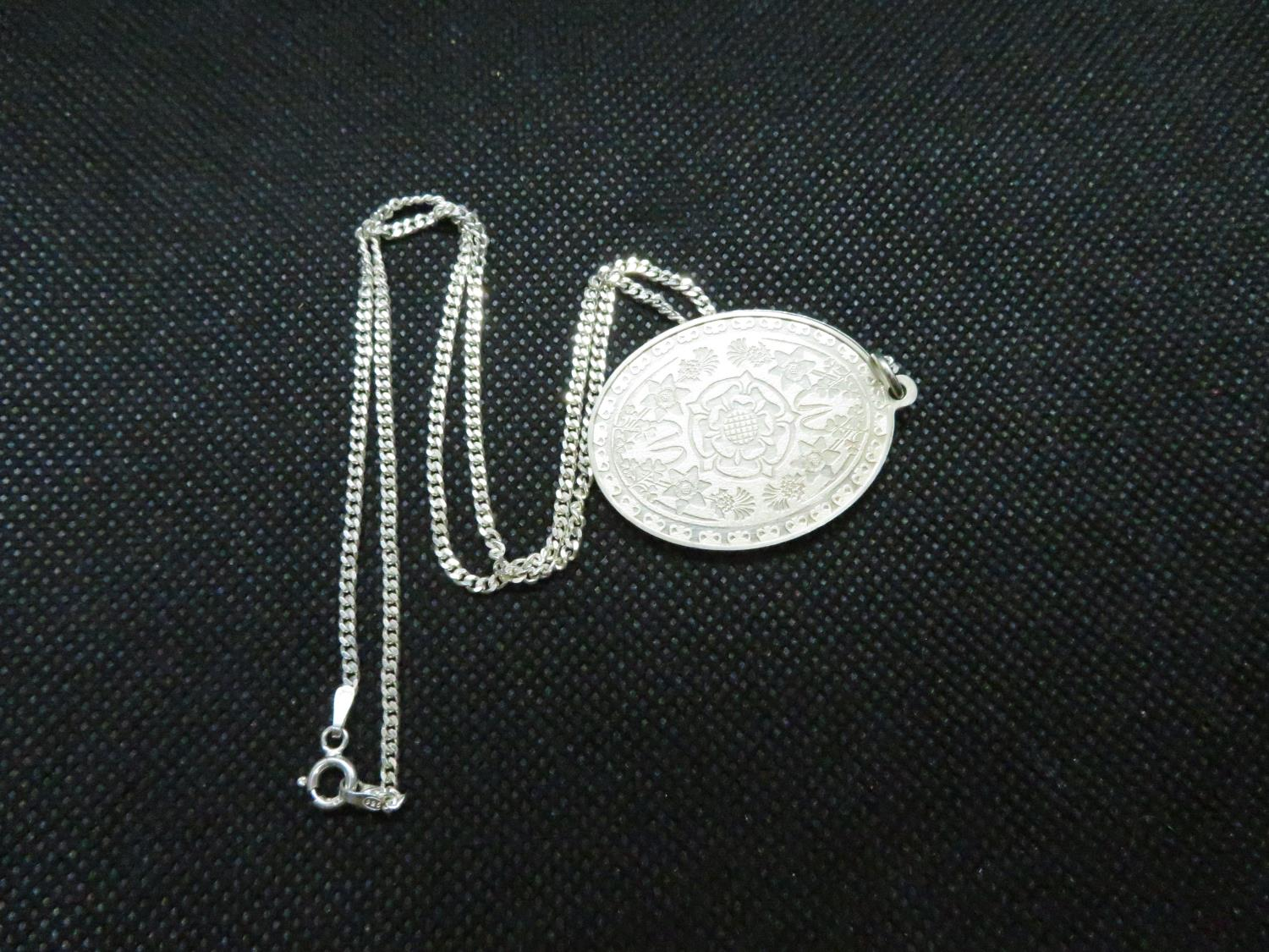 "Solid silver pendant celebrating QEII silver jubillee HM 1977 on 18"" silver curb link chain 18."