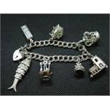 vintage silver double link charm bracelet with 7x large charms HM London 1977 50grams