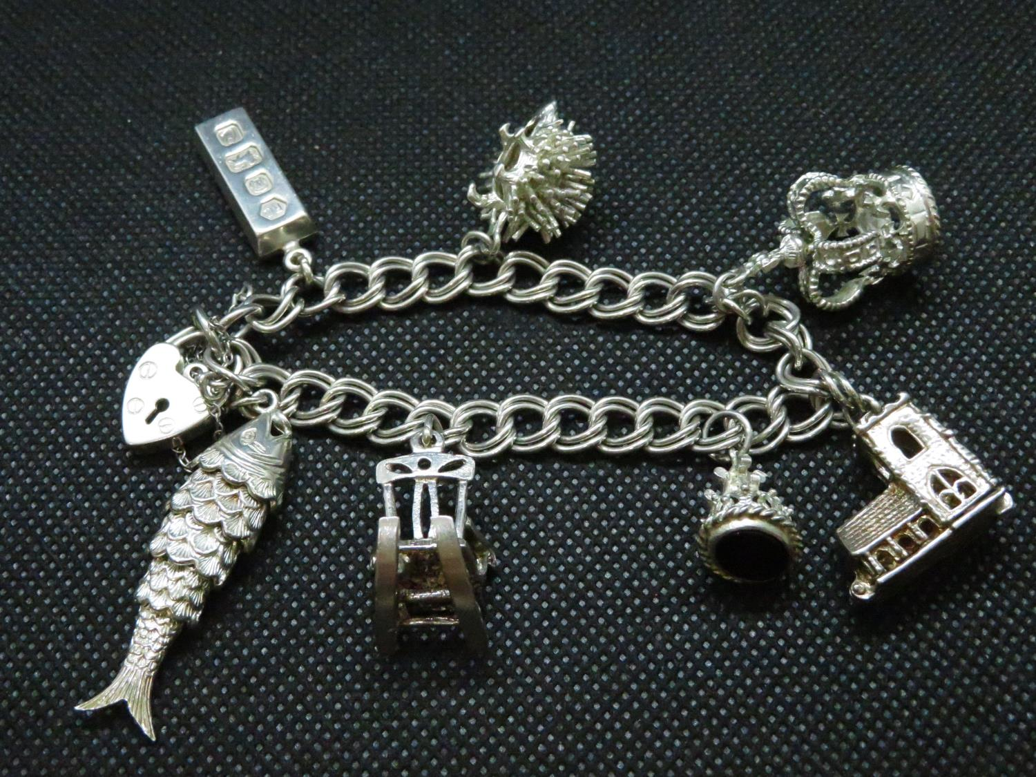 Lot 49 - vintage silver double link charm bracelet with 7x large charms HM London 1977 50grams