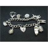 Vintage silver charm bracelet with 9x nice charms HM London 1978 65 grams