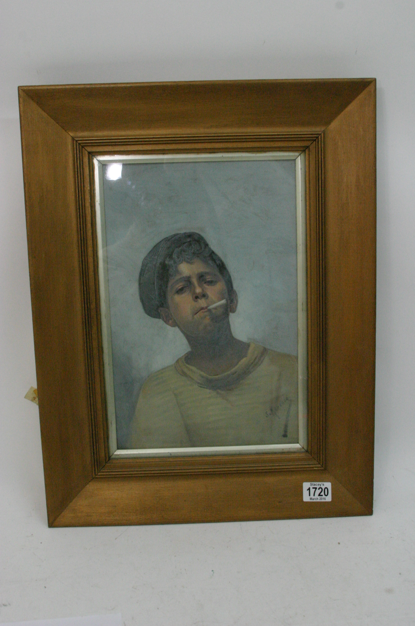 a framed oil painting on canvas study of of a boy smoking a