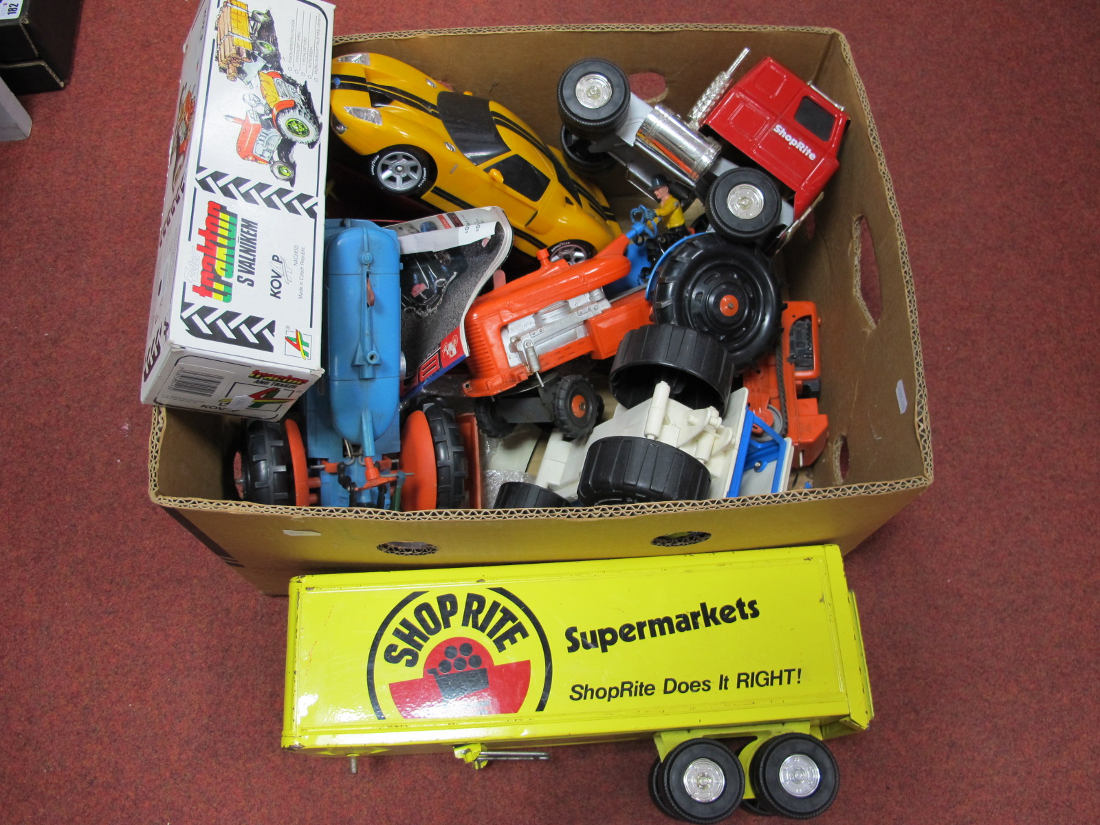 Lot 181 - A Tinplate Tractor and Trailer, made in Czech Republic, boxed, three Marx plastic tractors,
