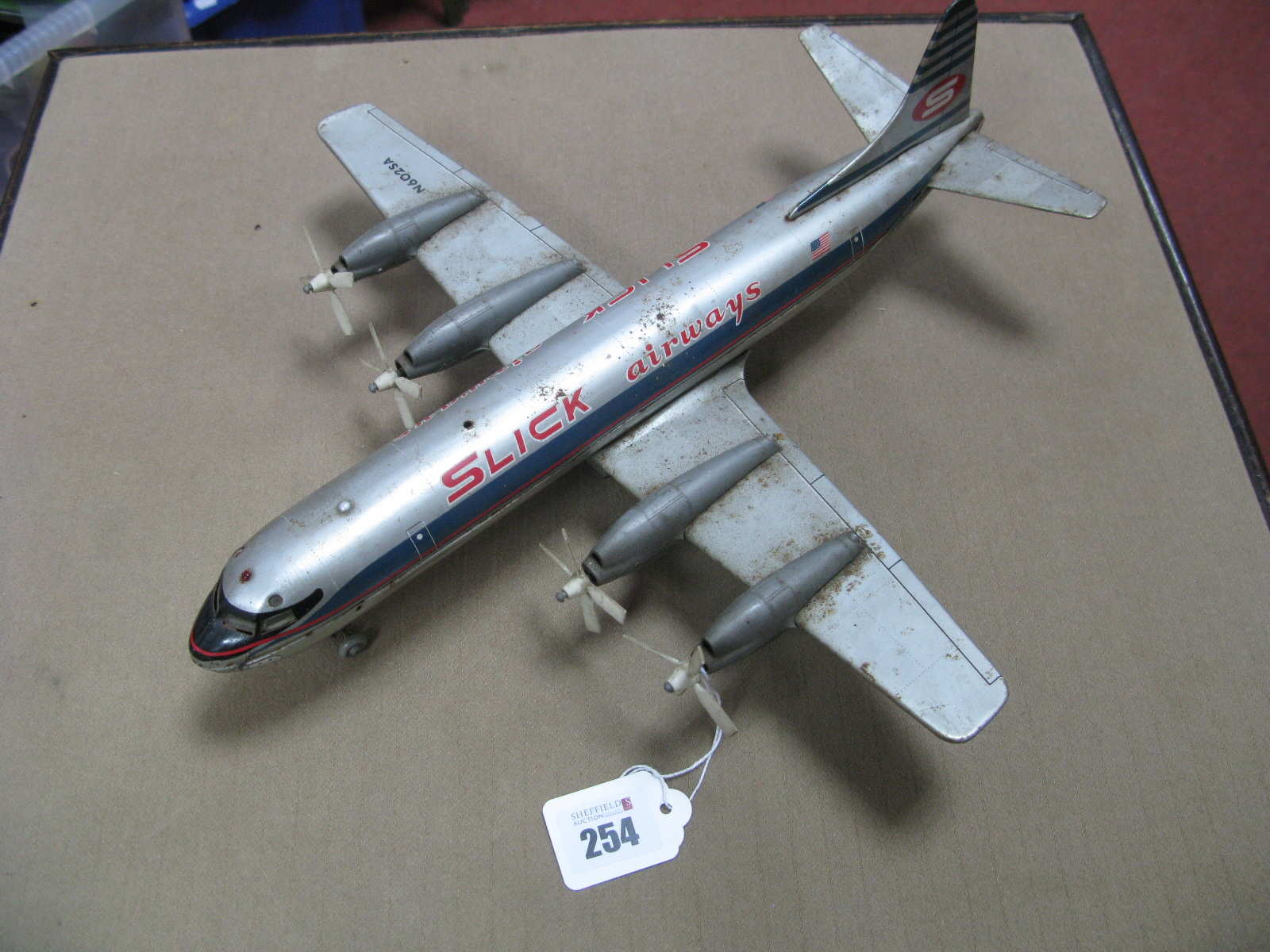 Lot 254 - A 1960's Battery Operated Tinplate Aircraft, by Marx, although Made In Japan, sign written - '