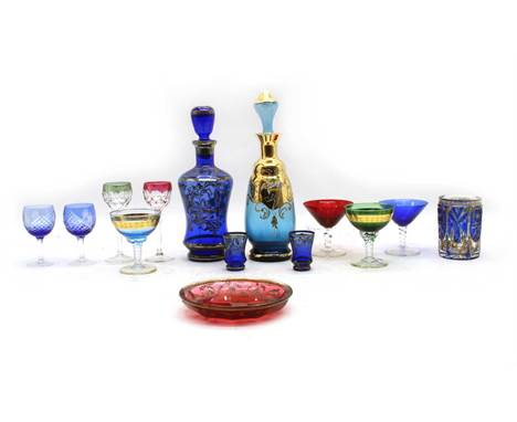 An antique Bohemian blue overlay glass and enamelled tumbler, c.1900, a similar red glass saucer dish and a large group of va