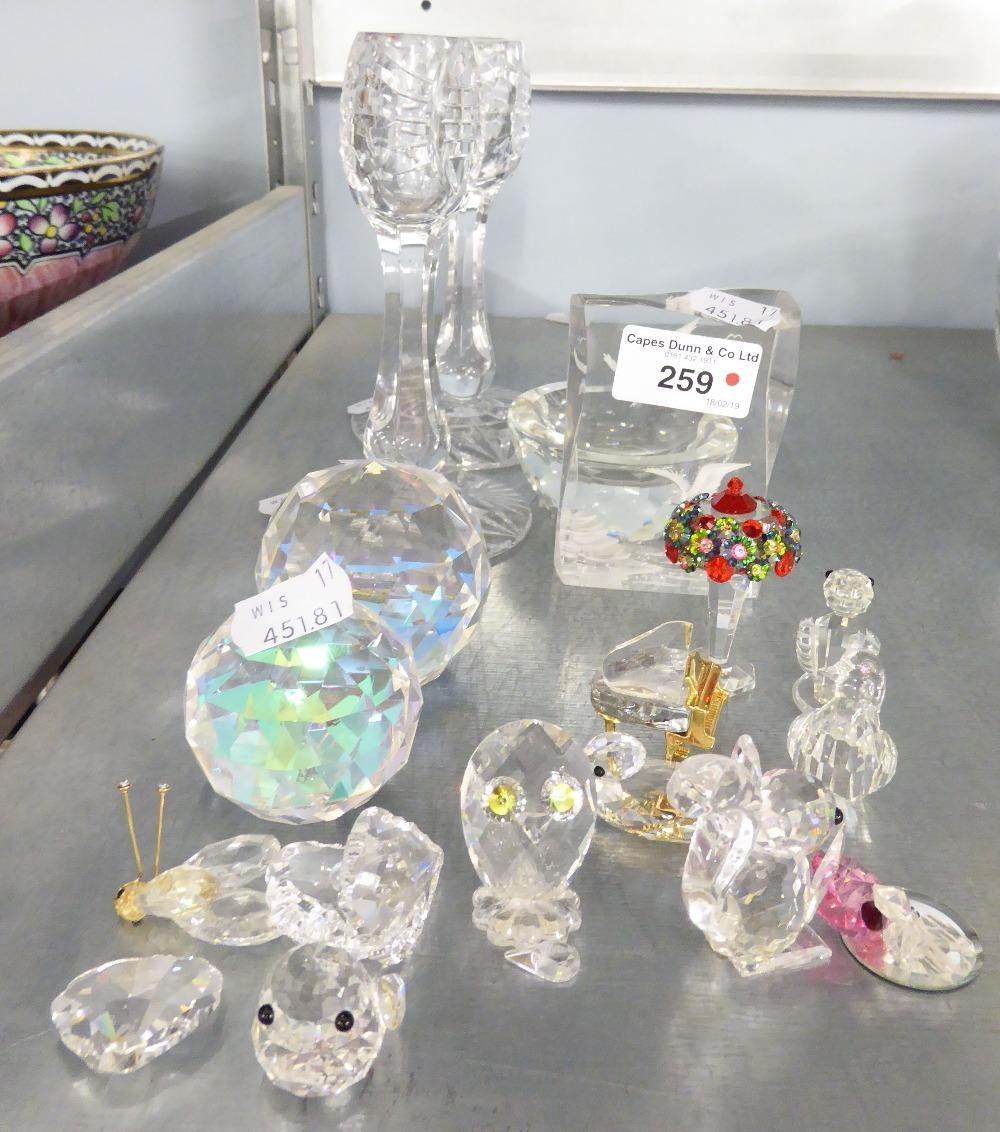 Lot 259 - A PAIR OF CUT GLASS CANDLESTICKS; TWO FACET GLASS PAPERWEIGHTS, TEN FACET GLASS MODELS OF BIRDS,