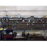 Pigeon hole rack including various machine tooling, for example angle plates, V-blocks etc