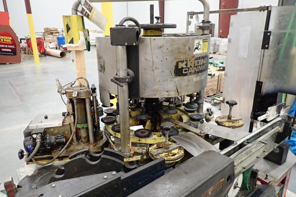 Lot 821 - Krones canmatic labeler, with controls, spare parts and change parts on (4) skids. - ** Located in B