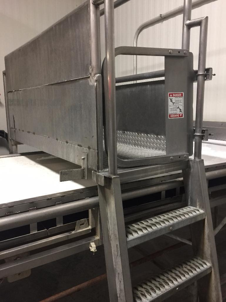 Lot 150 - SS conveyor cross over, 58 in. wide x 48 in. tall clear, steps and rail. - ** Located in South Beloi