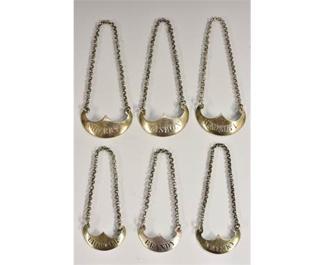 A set of three George III Scottish silver axe-head wine labels, Lisbon, Madeira and Sherry, engraved lettering, 4.5cm wide, R