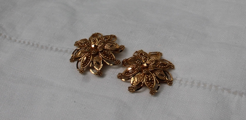 Lot 15 - A pair of Indian 22ct gold earrings,