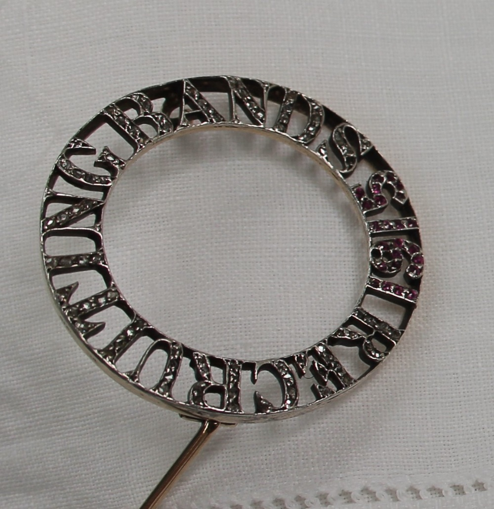 Lot 1 - Diamond and ruby recruiting bands brooch,