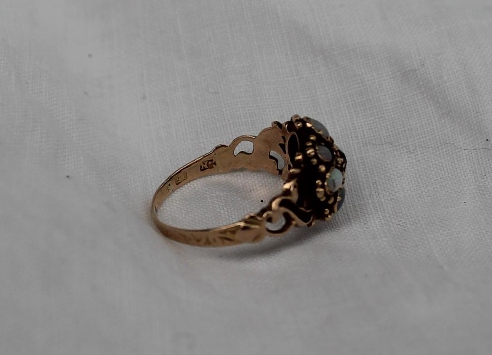 Lot 51 - A 15ct yellow gold opal set dress ring,