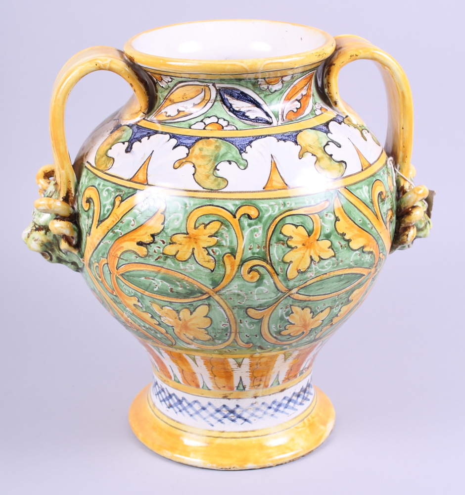 Lot 4 - A mid 20th century Majolica two-handled wet drug jar with yellow and green glaze