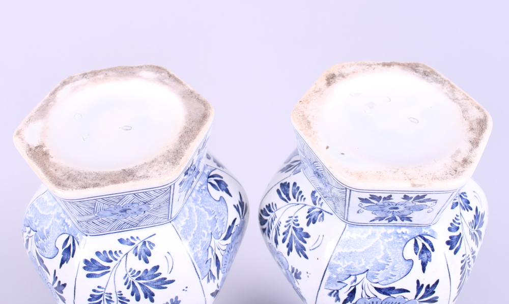 """Lot 22 - A pair of Delft hexagonal baluster vases with flared rims, 12"""" high"""